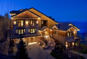 Craftsman Exterior of Home with Exposed beam, Exterior stucco walls, Wood shingle siding, River rock