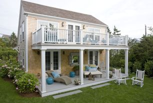 Cottage Exterior of Home with Rocking chair, Balcony, French doors, Covered patio, Wood shingle