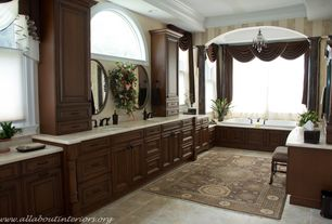 Traditional Master Bathroom with stone tile floors, Complex Marble, partial backsplash, Crown molding, Master bathroom