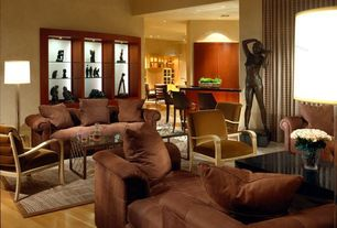 Contemporary Living Room with Built-in bookshelf, Laminate floors, can lights, High ceiling