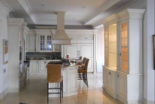 Traditional Kitchen with Kitchen island, can lights, Breakfast bar, Crown molding, Built In Panel Ready Refrigerator