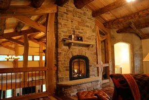 Country Living Room with brick fireplace, Standard height, Hardwood floors, Wood ceiling, stone fireplace, Exposed beam
