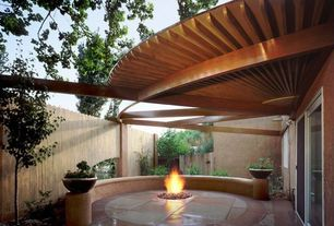 Contemporary Patio with exterior awning, Fire pit, Fence, Trellis, exterior stone floors, French doors