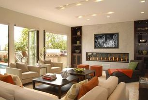 Contemporary Living Room with Standard height, French doors, Built-in bookshelf, can lights, Carpet, Fireplace