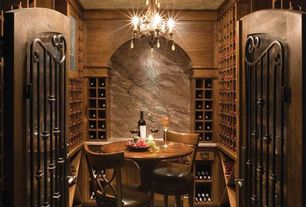 Mediterranean Wine Cellar with Minka-lavery, mini-chandeliers 3 light mini chandelier, Wood crown molding, Built in wine rack