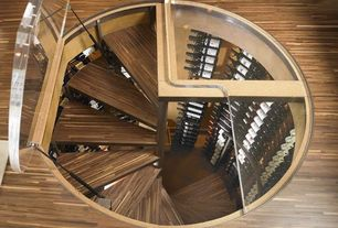 Contemporary Wine Cellar with Hardwood floors, Spiral staircase, Floor hatch