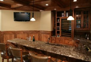 Craftsman Bar with Built-in bookshelf, Wainscotting, Chair rail, Pendant light, Box ceiling, Carpet