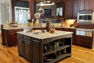 Country Kitchen with Flush, Simple granite counters, Kitchen island, French doors, Undermount sink, Pendant light, Columns