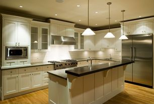 Traditional Kitchen with Flat panel cabinets, Shaker cabinet, Undermount sink, Crown molding, Simple granite counters
