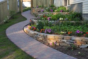 Traditional Landscape/Yard with Raised beds, Gate, Pathway, exterior brick floors, Fence