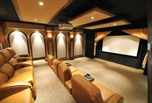 Modern Home Theater with Yellow theater seating, Wall sconce, Carpet, Ceiling mounted projector