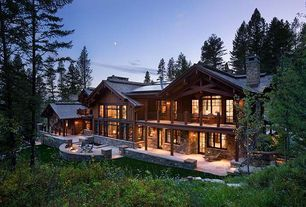 Country Exterior of Home with Wrap around porch, Exposed beam, Covered deck, Natural wood exterior, Natural stone exterior