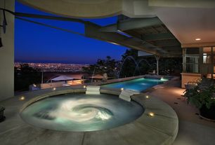 Contemporary Hot Tub with Fountain, Pool with hot tub, exterior tile floors, double-hung window, exterior awning