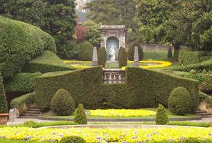 Traditional Landscape/Yard with Shell Obelisk, Fence, Pathway, Shell Obelisk, Formal garden, Raised beds