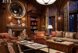 Traditional Living Room with Crown molding, French doors, Carpet, Arched window, Fireplace, Cement fireplace, Wall sconce