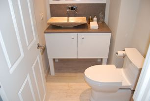 Contemporary Powder Room with Complex Marble, full backsplash, Vessel sink, Powder room, specialty door, Laminate floors