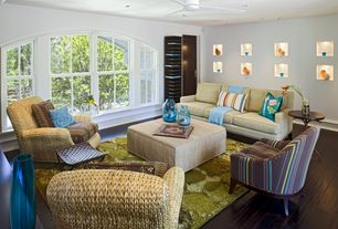 Contemporary Living Room with Ceiling fan, double-hung window, Standard height, can lights, Arched window, flat door