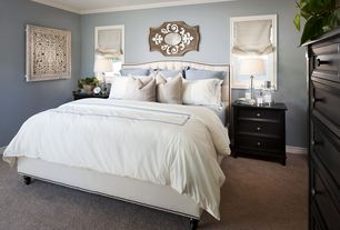 Traditional Master Bedroom with Crown molding, Pottery bard - raleigh upholstered camelback headboard & storage platform bed