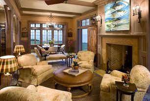 Traditional Living Room with Box ceiling, limestone floors, Crown molding, Wainscotting, Ceiling fan, Wall sconce, Columns