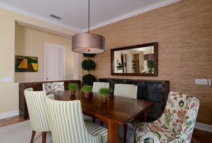 Contemporary Dining Room with Pendant light, interior wallpaper, Crown molding, travertine tile floors