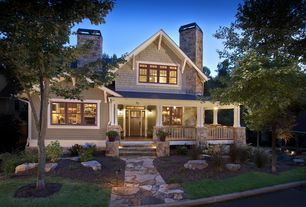 Craftsman Exterior of Home with Glass panel door, Transom window, exterior stone floors, Pathway, Fence, Covered front porch