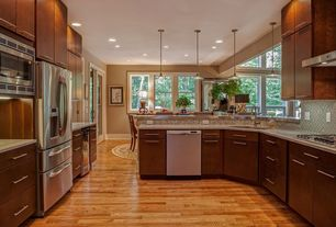 Traditional Kitchen with Wine refrigerator, Simple granite counters, Undermount sink, U-shaped, Pendant light, Breakfast nook