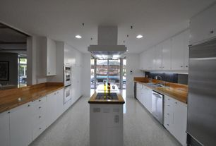 Contemporary Kitchen with Standard height, electric cooktop, Built In Refrigerator, Concrete floors, Flush, Wood counters