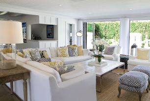 Contemporary Living Room with Ellyson Slipcovered Chair, Laminate floors, Harborside Slipcovered 3-Piece Sectional