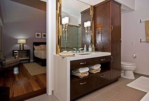Contemporary Master Bathroom with Standard height, frameless showerdoor, Undermount sink, Wall sconce, specialty tile floors