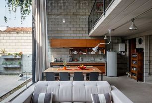Contemporary Great Room with picture window, Concrete floors, High ceiling, Balcony, Pendant light, Exposed brick