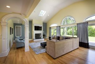 Contemporary Living Room with Columns, Hardwood floors, Skylight, Arched window, High ceiling