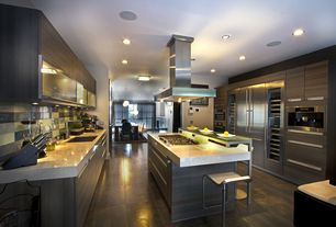 Contemporary Kitchen with Concrete tile , Island Hood, Flush, full backsplash, Standard height, double wall oven, Glass Tile