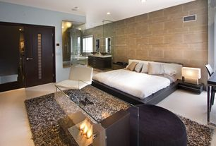 Contemporary Master Bedroom with Platform bed, Concrete floors, specialty door, Ceramic tile wall, Floor flame fireplace
