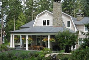 Cottage Patio with Eldorado stone limestone - york, Gambrel roof, Covered patio, Glass panel door, Wrap around porch