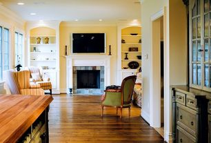 Traditional Great Room with Carved Ornate Wingback ARM CHAIR, Fireplace, Black Wood Pillar Candleholder, High ceiling