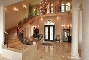 Mediterranean Entryway with Loft, picture window, Cathedral ceiling, French doors, can lights, Columns, Chandelier