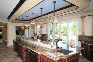 Traditional Kitchen with Pendant light, Glass Tile, Kitchen island, Arched window, Framed Partial Panel, stone tile floors