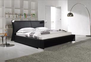 Contemporary Master Bedroom with Upholstered headboard, Mobital arc floor lamp, stone tile floors, Built-in bookshelf