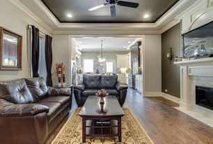 Traditional Living Room with Paint 1, Paint 2, Fireplace, Crown molding, Hardwood floors, Area rug