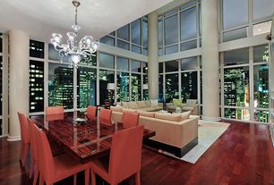 Modern Dining Room with Alvise 3 Lights Chandelier, Hardwood floors, Crate & Barrel Folio Bonded Leather Side Chair