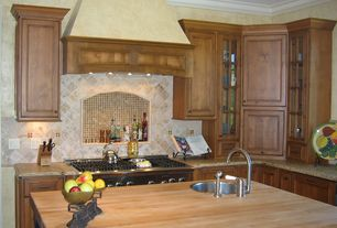 Traditional Kitchen with Ms international almond gold granite, Custom hood, Glass panel, Kitchen island, Crown molding