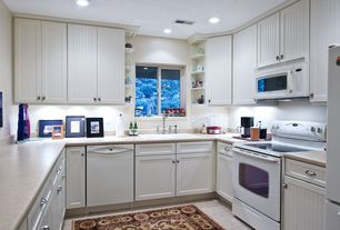 Cottage Kitchen with large ceramic tile floors, Drop-in sink, built-in microwave, Flat panel cabinets, Standard height