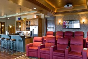 Modern Home Theater with Projector, Wall sconce, Matinee home theater connector chair, Built in bar, Area rug, Cove lighting