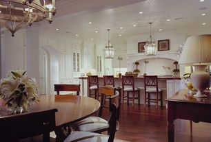 Traditional Dining Room with Chandelier, Laminate floors, Columns