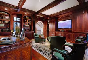 Traditional Home Office with Standard height, Exposed beam, can lights, six panel door, Laminate floors, Built-in bookshelf