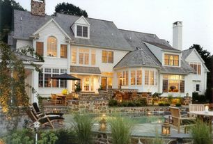 Traditional Exterior of Home with Transom window, Arched window, exterior tile floors, French doors
