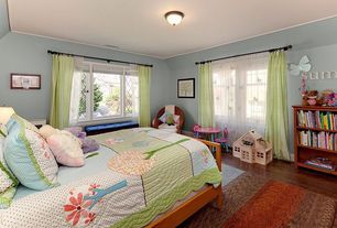 Traditional Kids Bedroom with Casement, Hardwood floors, flush light, Standard height, specialty window