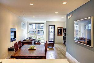 Contemporary Dining Room with Laminate floors, Glass panel door, Built-in bookshelf