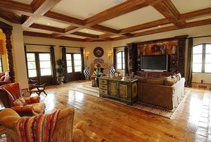 Traditional Living Room with Wall sconce, Box ceiling, Exposed beam, Glass panel door, Hardwood floors, Cement fireplace