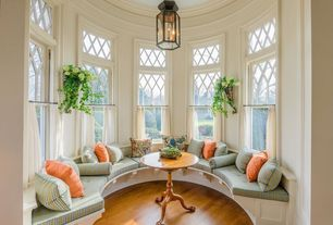 Traditional Living Room with Hardwood floors, Bench seating, Cafe curtains, Transom window, Custom built-in bench seating